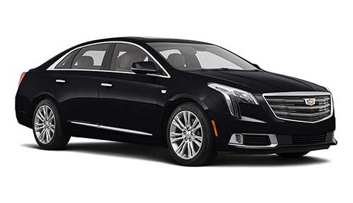Side view of Cadillac XTS sedan available for rent from LimoRSVP in Chicago, IL