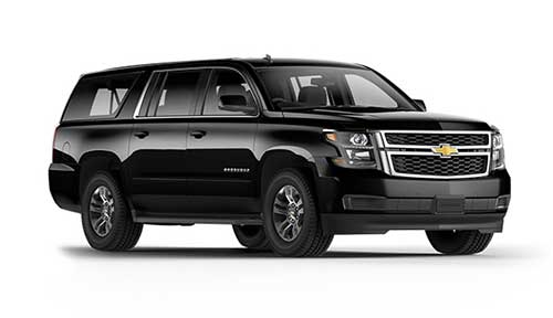 Side view of Chevrolet Suburban available for rent from LimoRSVP in Chicago, IL